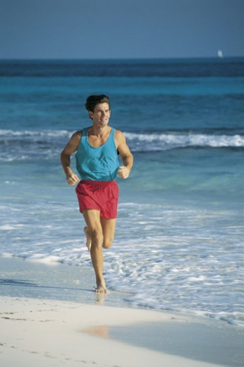 Stock Photo: 1557R-280226 Man running on beach