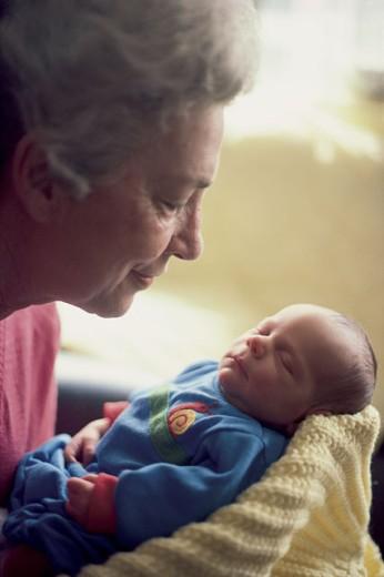 Grandmother holding newborn infant : Stock Photo