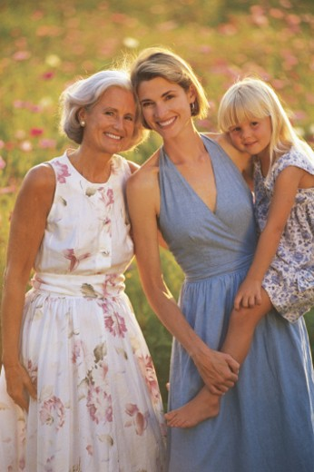 Stock Photo: 1557R-281219 Grandmother posing with daughter and granddaughter