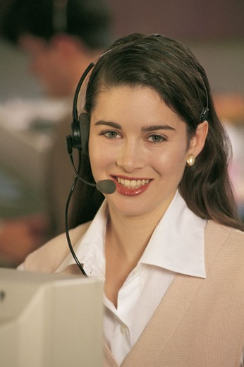 Portrait of woman customer service representative with headset : Stock Photo