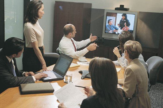 Business meeting with teleconference : Stock Photo