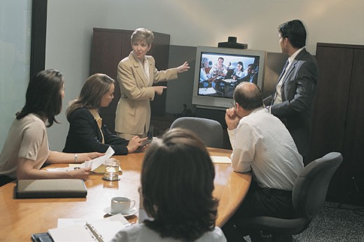 Stock Photo: 1557R-281578 Business meeting with teleconference