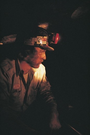 Coal miner with light : Stock Photo