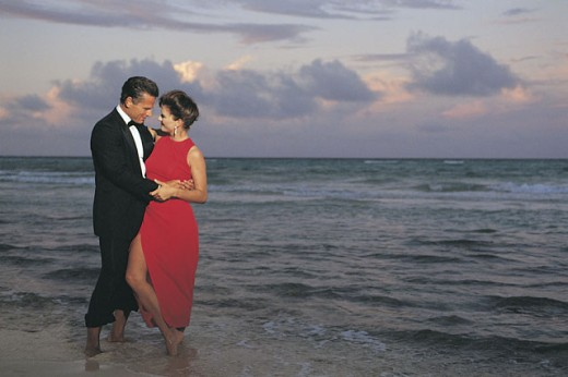 Stock Photo: 1557R-281606 Couple in formal attire on beach