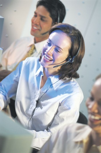 Customer service agent with headset smiling : Stock Photo