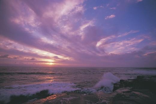 Sunset over ocean : Stock Photo