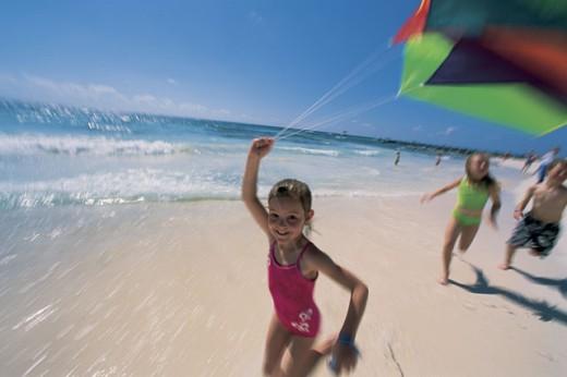Children flying kite on beach : Stock Photo