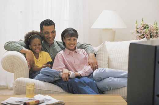 Stock Photo: 1557R-282518 Family watching TV at home