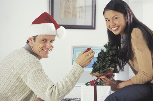 Stock Photo: 1557R-282736 Couple posing with Santa hat