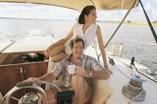 Stock Photo: 1557R-283044 Couple relaxing on boat