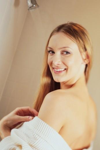 Woman posing in bathrobe : Stock Photo