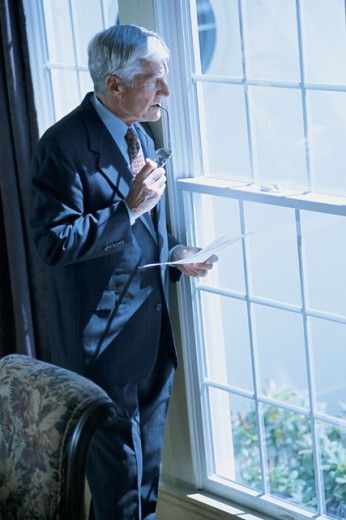 Businessman looking out window : Stock Photo
