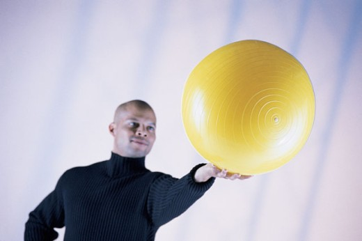 Man holding yoga ball : Stock Photo