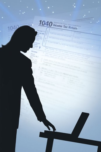 Businessperson with computer and income tax form : Stock Photo