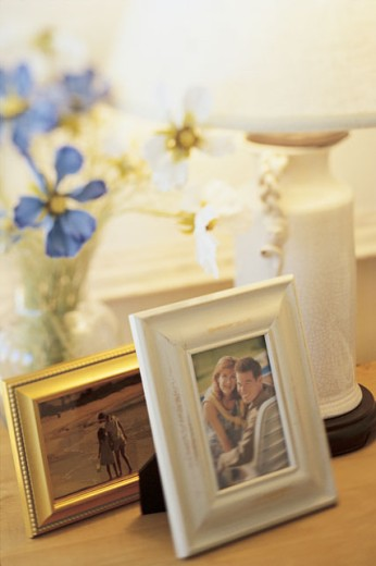 Photos and lamp in home : Stock Photo