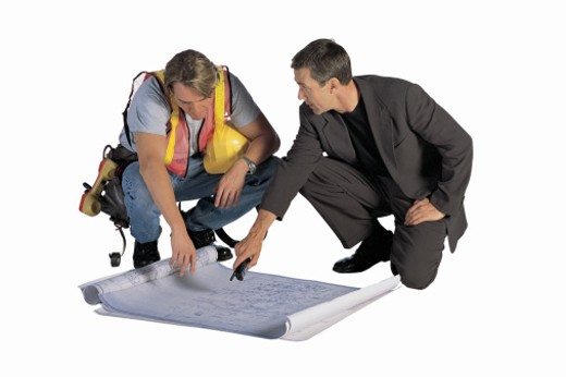 Stock Photo: 1557R-284298 Construction worker and businessman with blueprints
