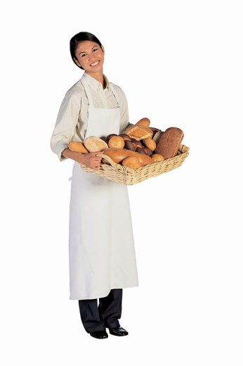 Baker with tray of assorted breads : Stock Photo