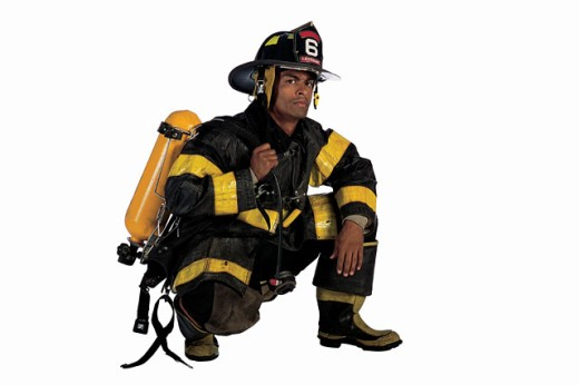 Stock Photo: 1557R-284313 Fireman crouching