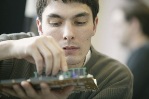 Computer technician with circuit board : Stock Photo