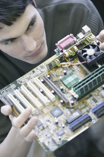 Computer technician with motherboard : Stock Photo