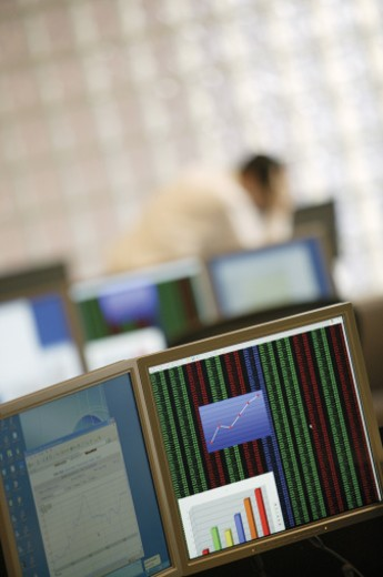 Computer screens with graphs : Stock Photo