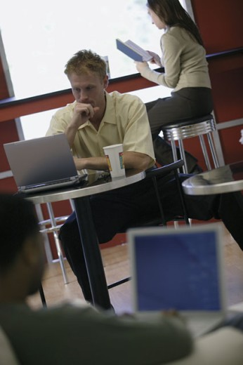 Man at internet cafe : Stock Photo