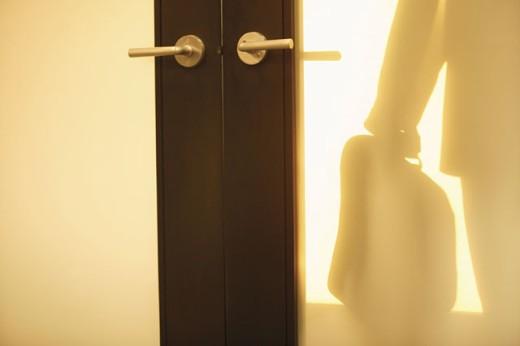 Businessman through office doors : Stock Photo