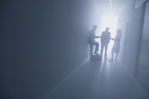 Stock Photo: 1557R-285957 Businesspeople talking in a hallway