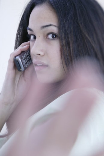 Stock Photo: 1557R-286292 Teenage girl on telephone