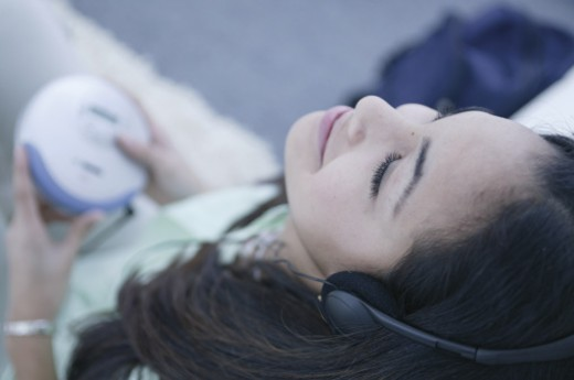 Teenager listening to music : Stock Photo