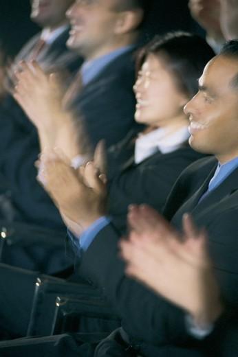 Audience applauding : Stock Photo