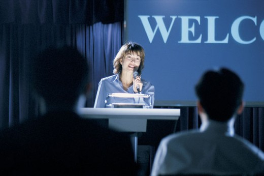 Stock Photo: 1557R-286559 Woman giving presentation