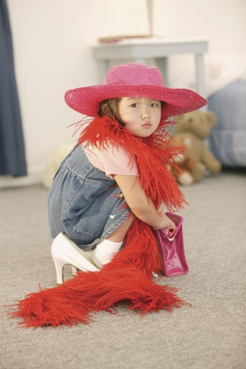 Girl playing dress-up : Stock Photo