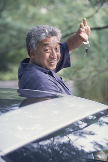 Man getting out of car : Stock Photo