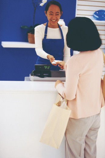 Stock Photo: 1557R-287393 Teenager assisting customer at retail store
