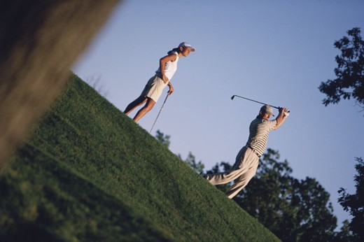 Stock Photo: 1557R-287402 Couple playing golf