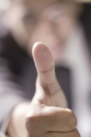 Stock Photo: 1557R-288736 Man giving thumbs-up sign