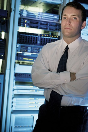 Man in server room : Stock Photo