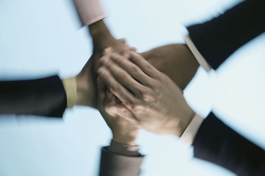 Business people's hands piled on top of one another : Stock Photo
