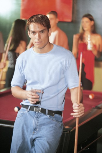 Stock Photo: 1557R-289527 Man holding pool cue