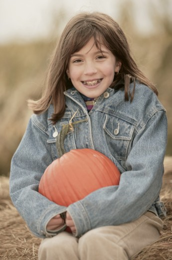 Girl with pumpkin : Stock Photo