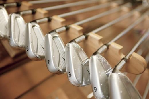 Stock Photo: 1557R-290310 Golf clubs on rack