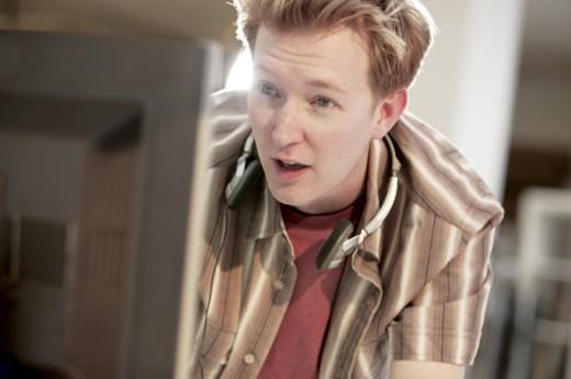 Man at computer : Stock Photo
