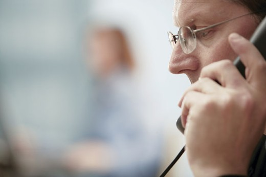 Stock Photo: 1557R-291017 Man talking on telephone