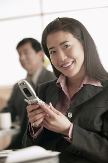 Businesswoman with cell phone : Stock Photo