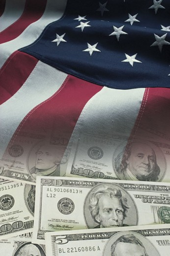 American flag and money : Stock Photo