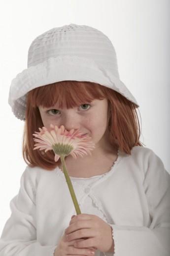 Stock Photo: 1557R-291871 Girl smelling flower