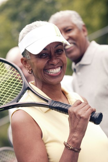 Portrait of woman with tennis gear : Stock Photo