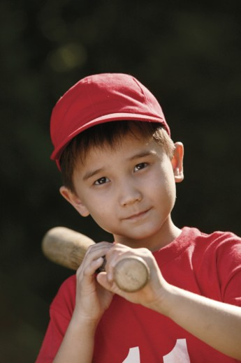 Portrait of boy in baseball uniform : Stock Photo