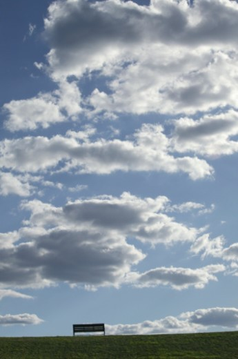 Clouds over a field : Stock Photo